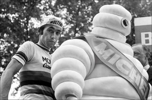 Eddie Merckx joins the Michelin man on the podium in 1975
