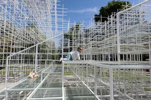 18 month old toddler Helmi enjoys climbing on Sou Fujimoto's Pavilion