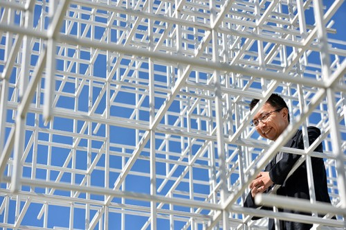 Japanese architect Sou Fujimoto poses in the Serpentne pavilion
