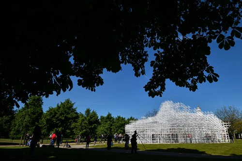 People take pictures of Sou Fujimoto's pavilion. The Serpentine gallery roo