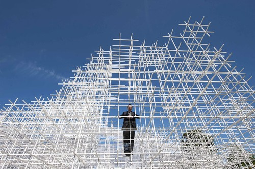 Sou Fujimoto stands inside his Serpentine Gallery pavilion