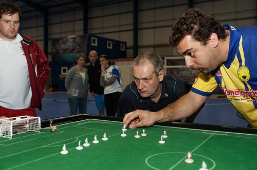 Alan Collins, honourable life president of the Federation of International Sports Table Football, referees a close game at the Cardiff Grand Prix, 2011